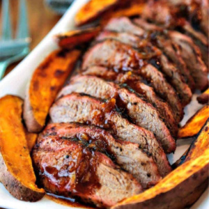 A plate of slice pork tenderloin and sweet potato fries, with Grilling and Pork