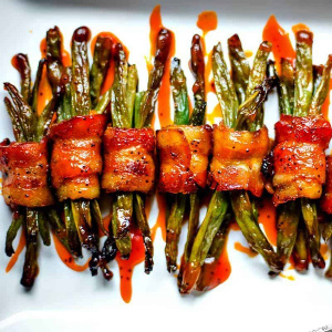 A bunch of bacon wrapped green beans on a plate