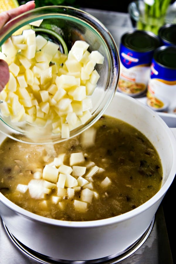 diced potatoes going into chowder on the stove