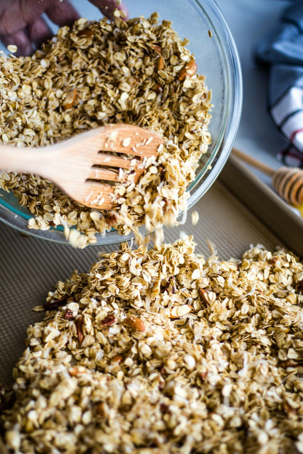 spread coated granola evenly onto a baking sheet