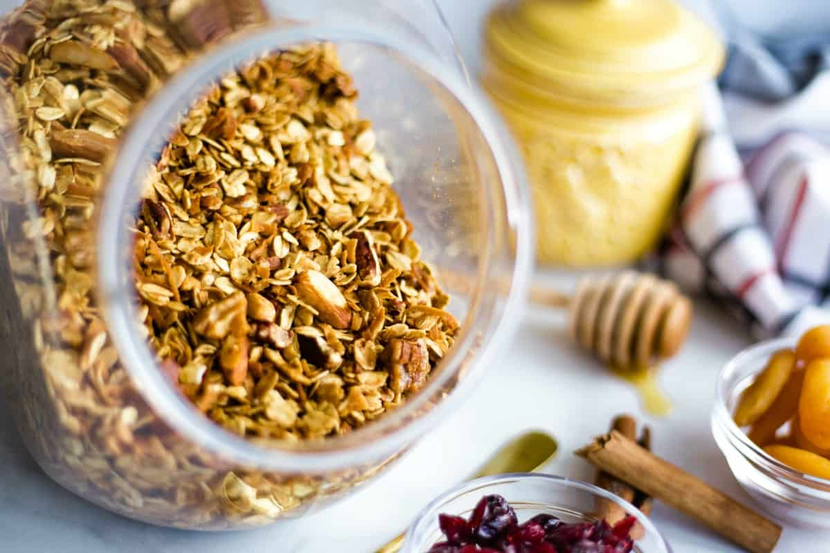 Homemade granola with nuts stored in an air-tight container.