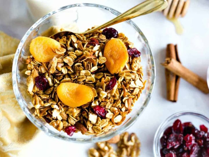 Nutty Granola in a glass bowl with dried apricots and cranberries