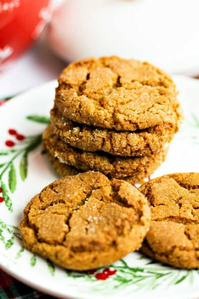 a stack of ginger cookies on a holly painted plate