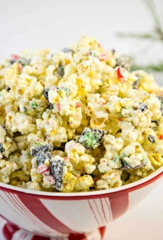 white chocolate peppermint popcorn in a festive bowl