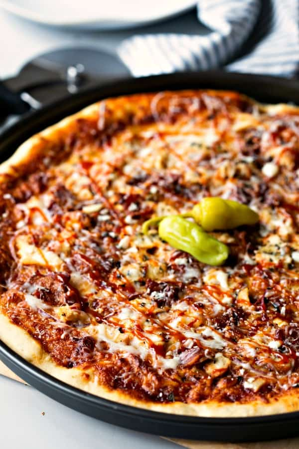 Barbecue Chicken Pizza garnished with pepperoncini peppers