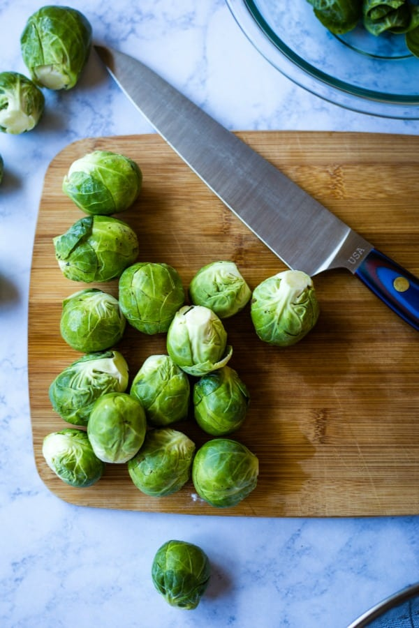 Brussels Sprouts on cutting board with knife