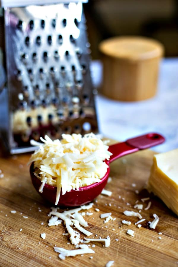 shredded asiago cheese with grater