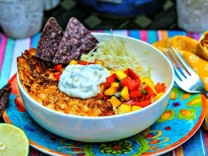 A bowl of food on a plate, with Fish Tacos