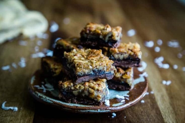 These gooey dessert bars are the ultimate in chocolate decadence with a chocolate shortbread crust, chocolate pecan pie filling, and toasted pecans.