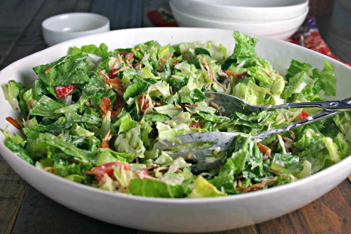 A bowl of salad, with insalata della casa and Ranch dressing