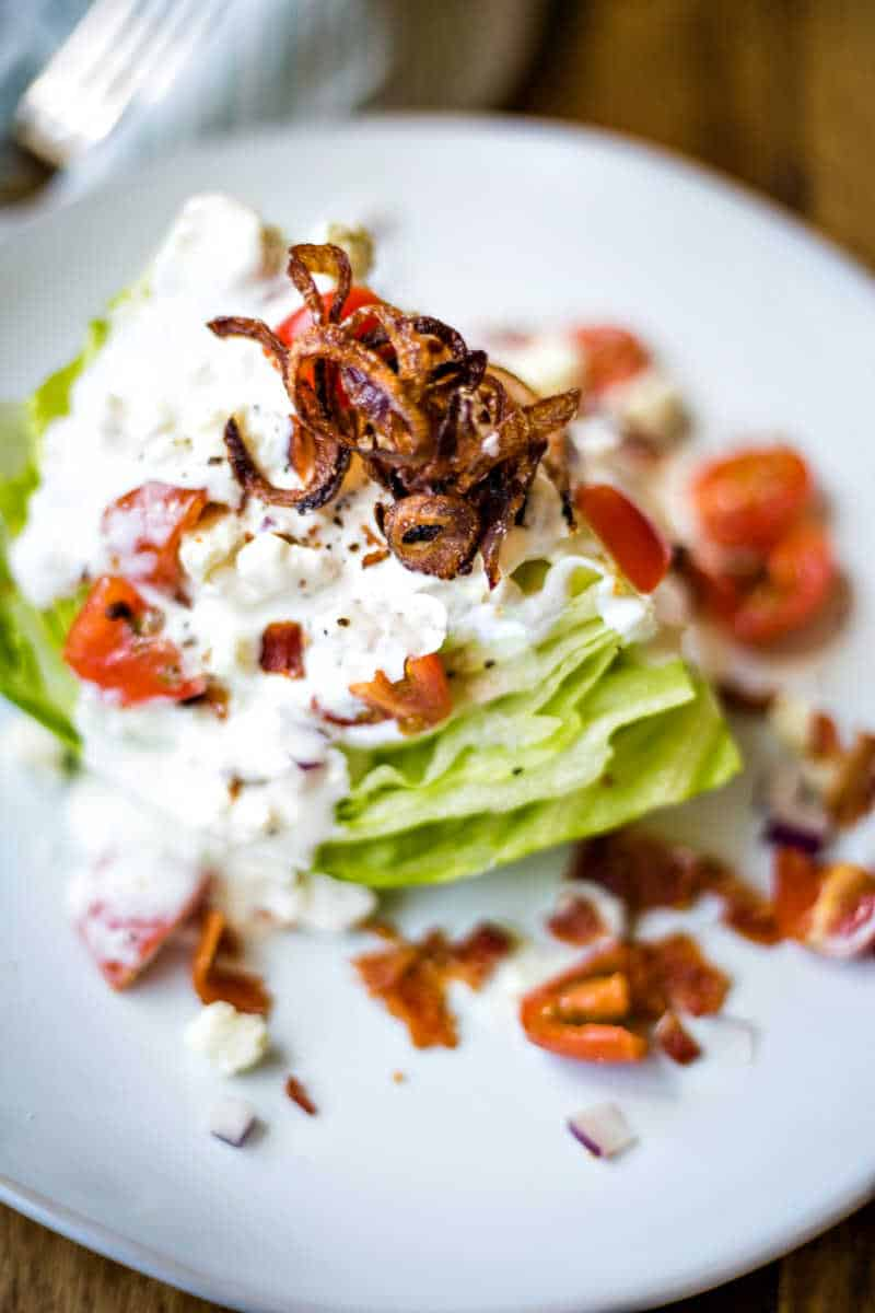 crispy shallots on a wedge salad with buttermilk blue cheese dressing