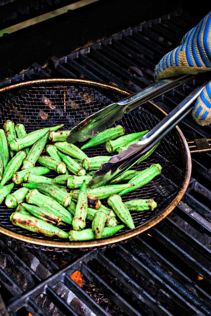 A pan of food on a grill, with Okra