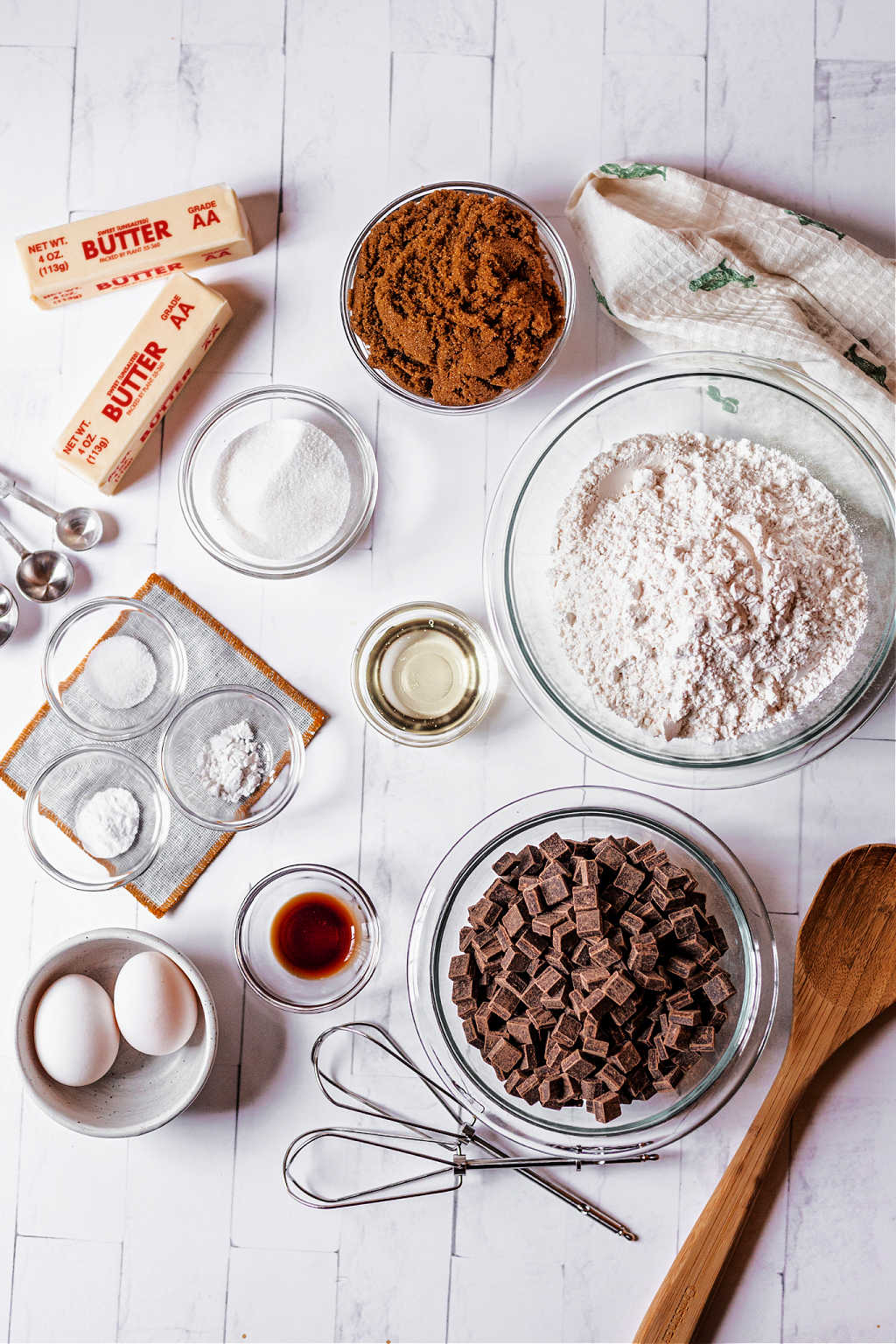 ingredients for chocolate chunk cookies on a white background.