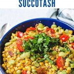 a blue bowl filled with corn succotash.