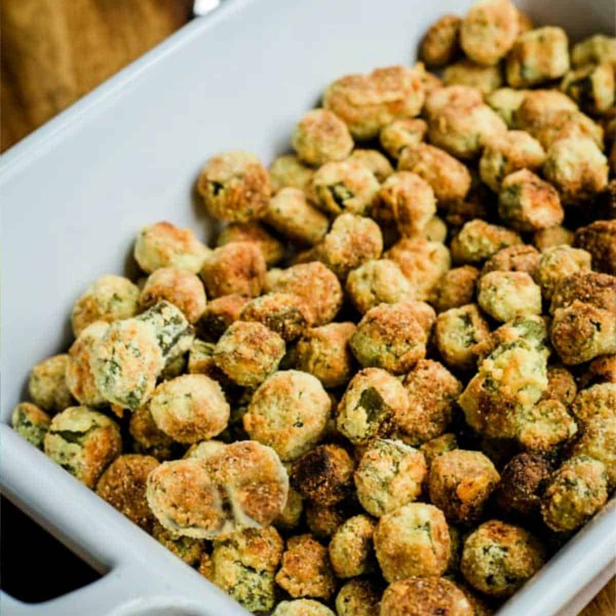 oven fried okra in a white serving bowl