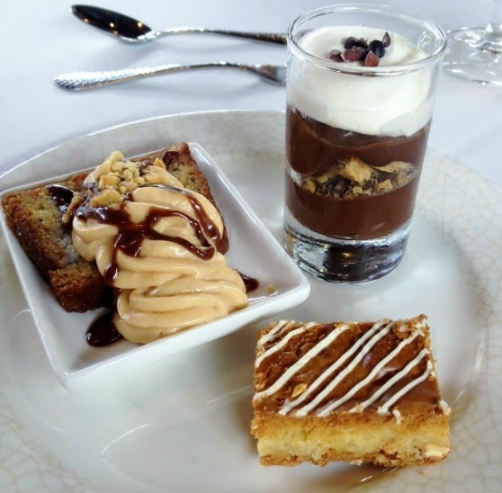 Banana Bread with Caramel Mousse, Chocolate Sauce and Salted Peanuts; Dark Chocolate Pudding with Malt Cream; and White Chocolate Brownies by Biltmore