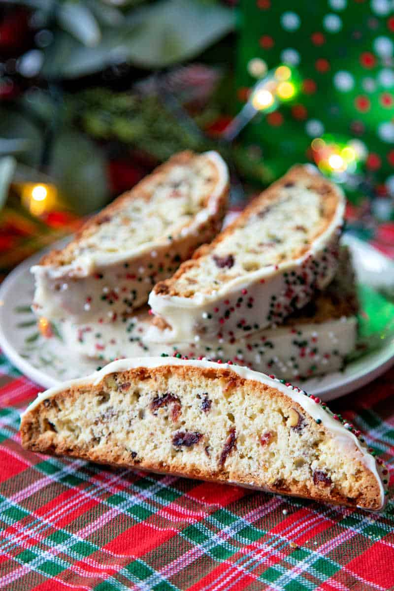 cranberry pistachio biscotti on a table decorated for Christmas