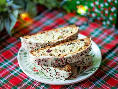 a plate of biscotti on a red tartan tablecloth