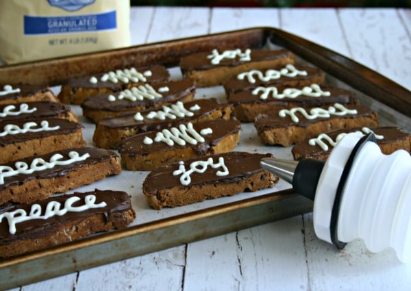 decorating espresso chocolate chip biscotti with piping icing
