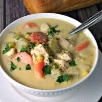 A bowl of Cheesy Chicken Vegetable Chowder on a plate