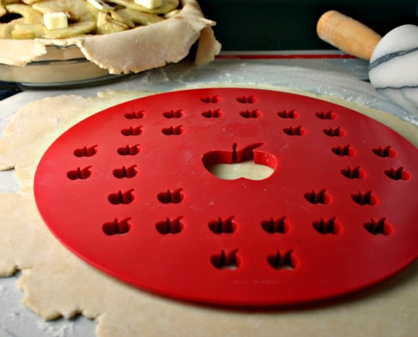 A close up of a pie shape cut out on a table, with Mom\'s apple pie