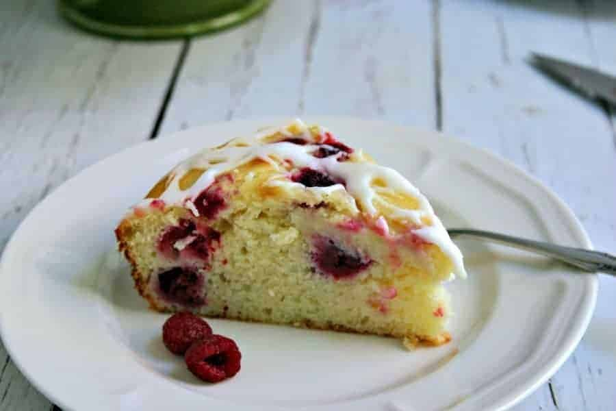 A piece of cake on a plate, with Raspberry Ricotta Cake
