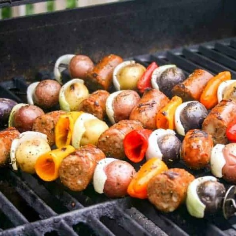 A close up of food on a grill, with Italian Skewers