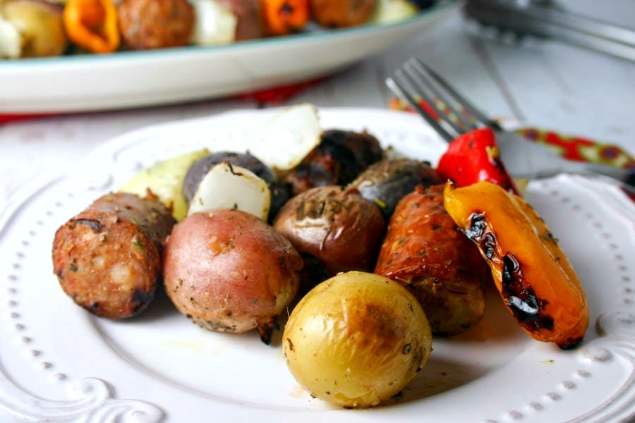 A plate of food, with Italian Skewers with potatoes and sausages