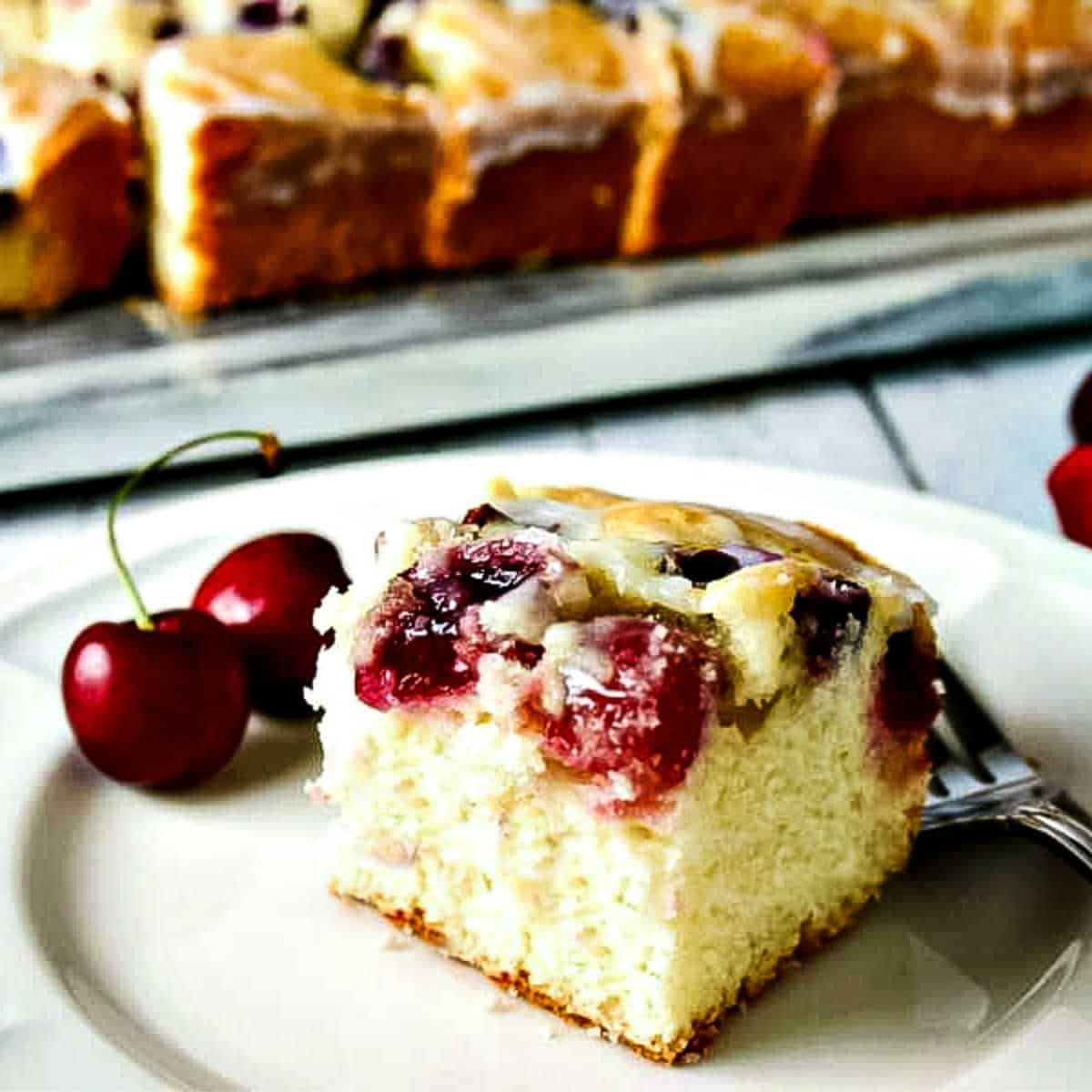 a piece of cherry cake on a white plate
