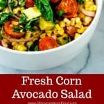 Fresh Corn Avocado Salad with basil and red onions in a white bowl
