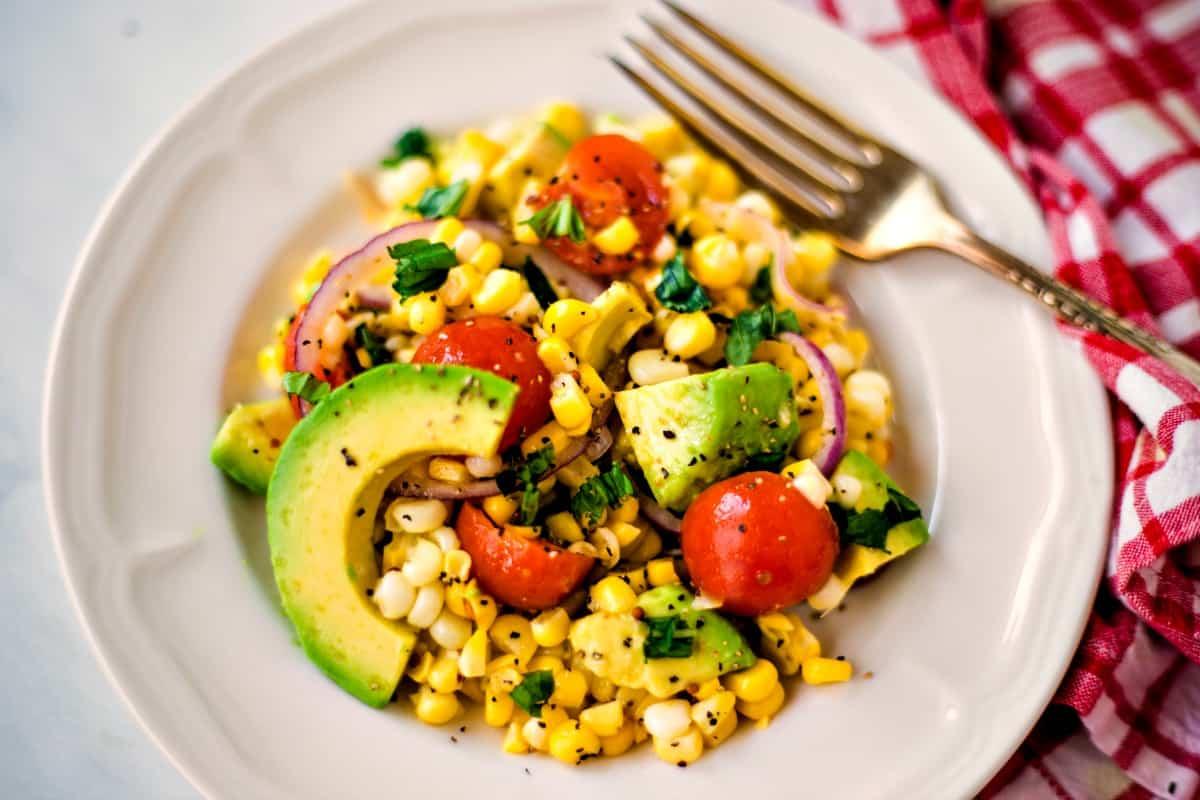 corn salad with sliced avocado