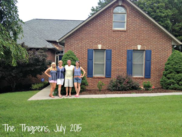 A family standing in front of a house