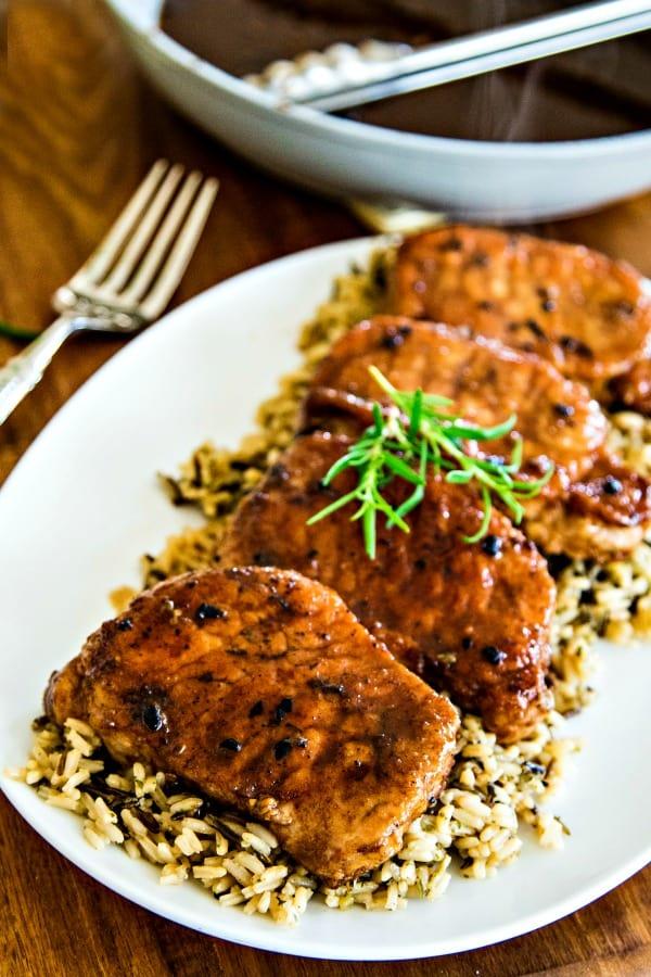 balsamic pork chops on a white platter