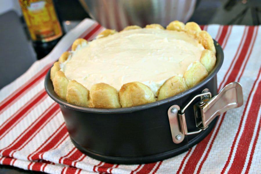 A springform cake pan on a table, with Kajlua White Chocolate Tiramisu