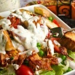 A bowl of food, with Seven-Layer Salad and Parmesan Ranch dressing