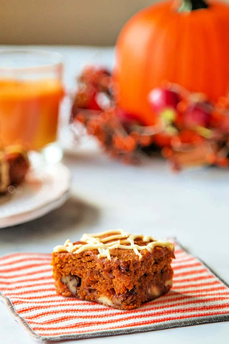 A close up of a slice of cake on a plate, with Pumpkin and White Chocolate