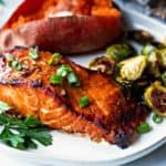 Best Grilled Salmon on a white plate with baked sweet potato