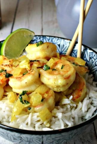 A bowl of food, with Coconut Curry Shrimp