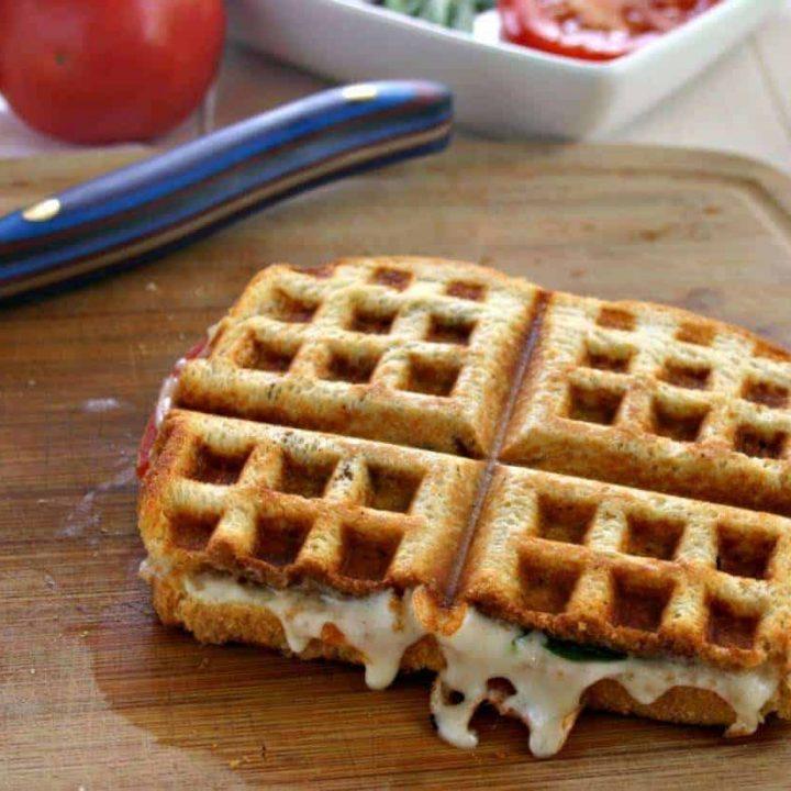 A Bruschetta Waffle Panini on a cutting board