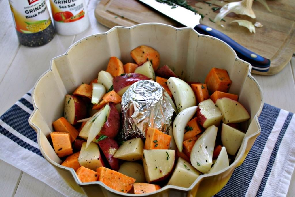 A Bundt pan filled with chinks of vegetables, with Rotisserie Chicken and roasted vegetables