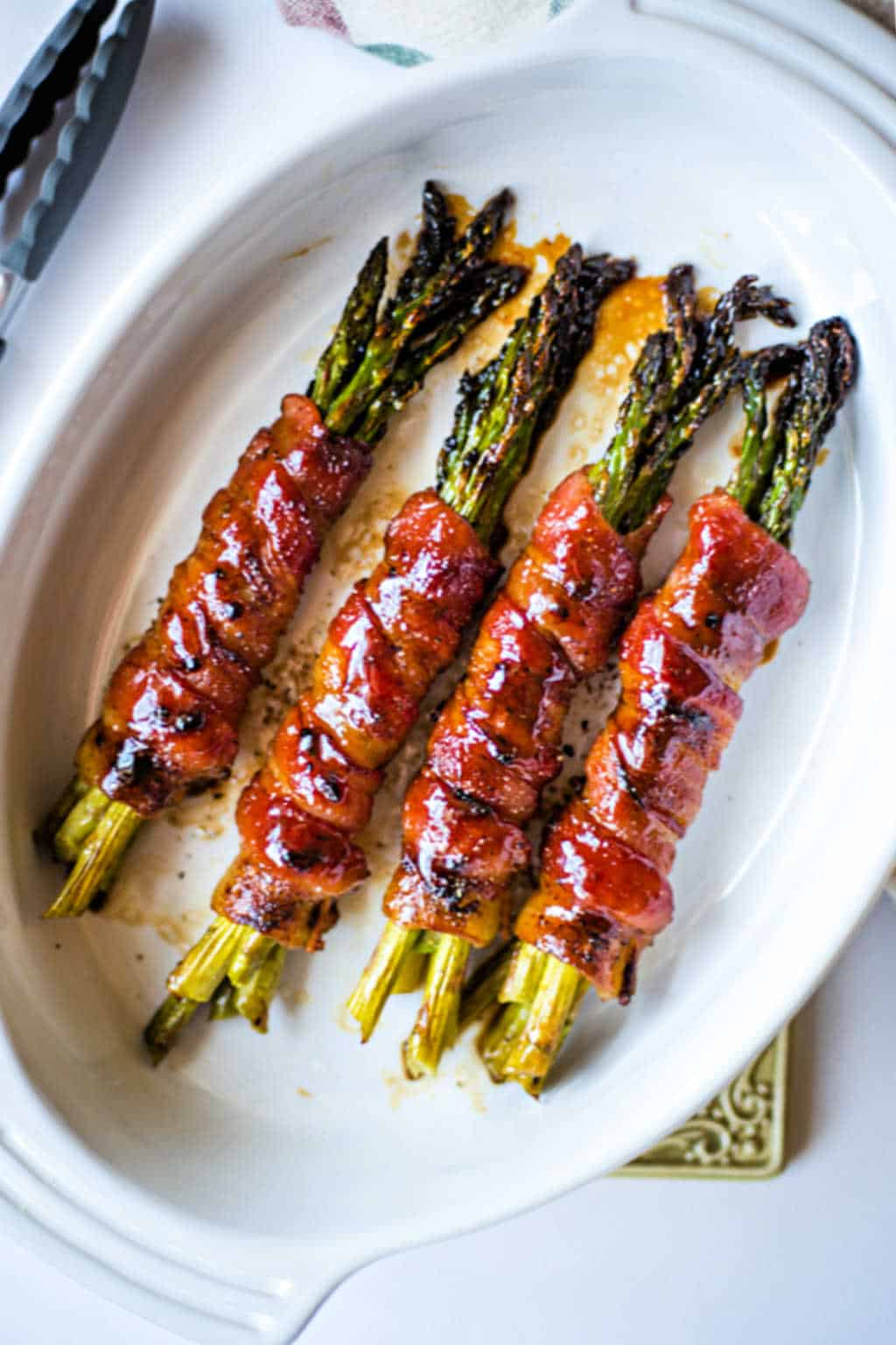 Bacon Wrapped Asparagus in a white baking dish