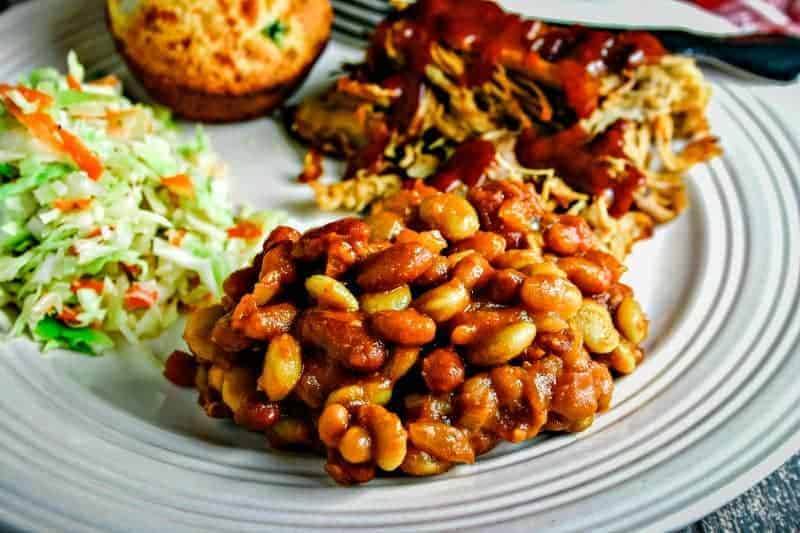 mixed baked beans on white plate