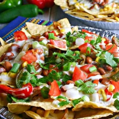 Supreme Veggie Nachos with Green Chili Cheese Sauce