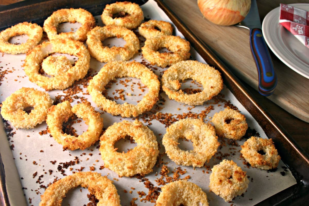 A close up of a tray of dCrispy Oven Baked Onion Rings on a table