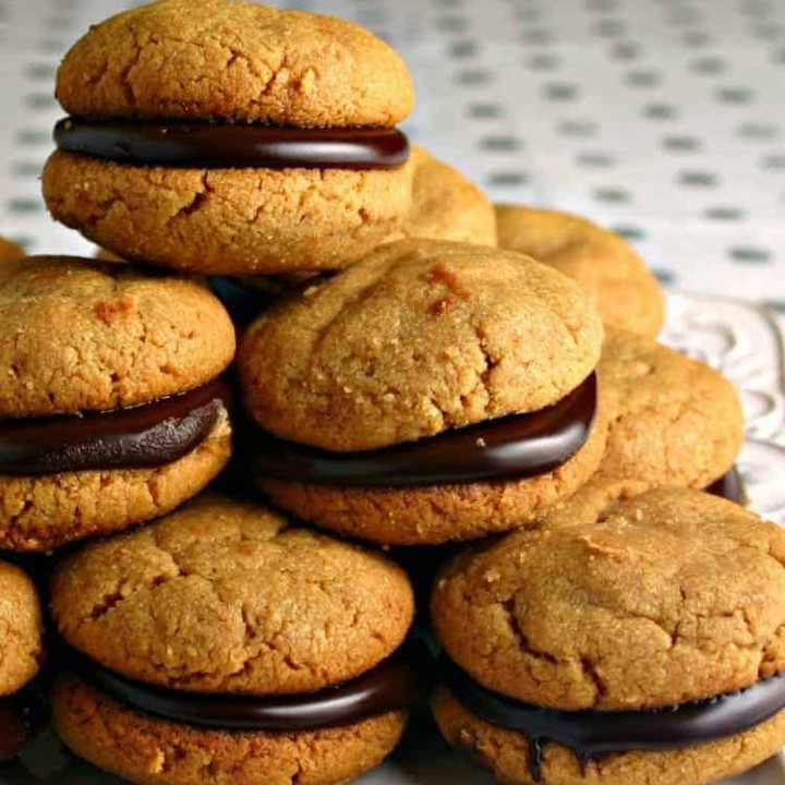 Food on a plate, with flourless peanut butter and Chocolate sandwich cookies