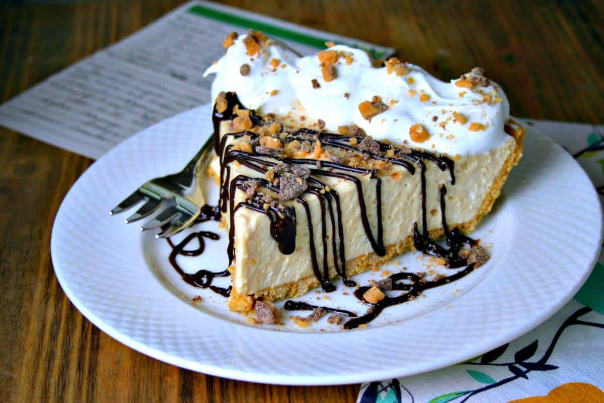 A piece of pie on a plate, with Peanut Butter Pie