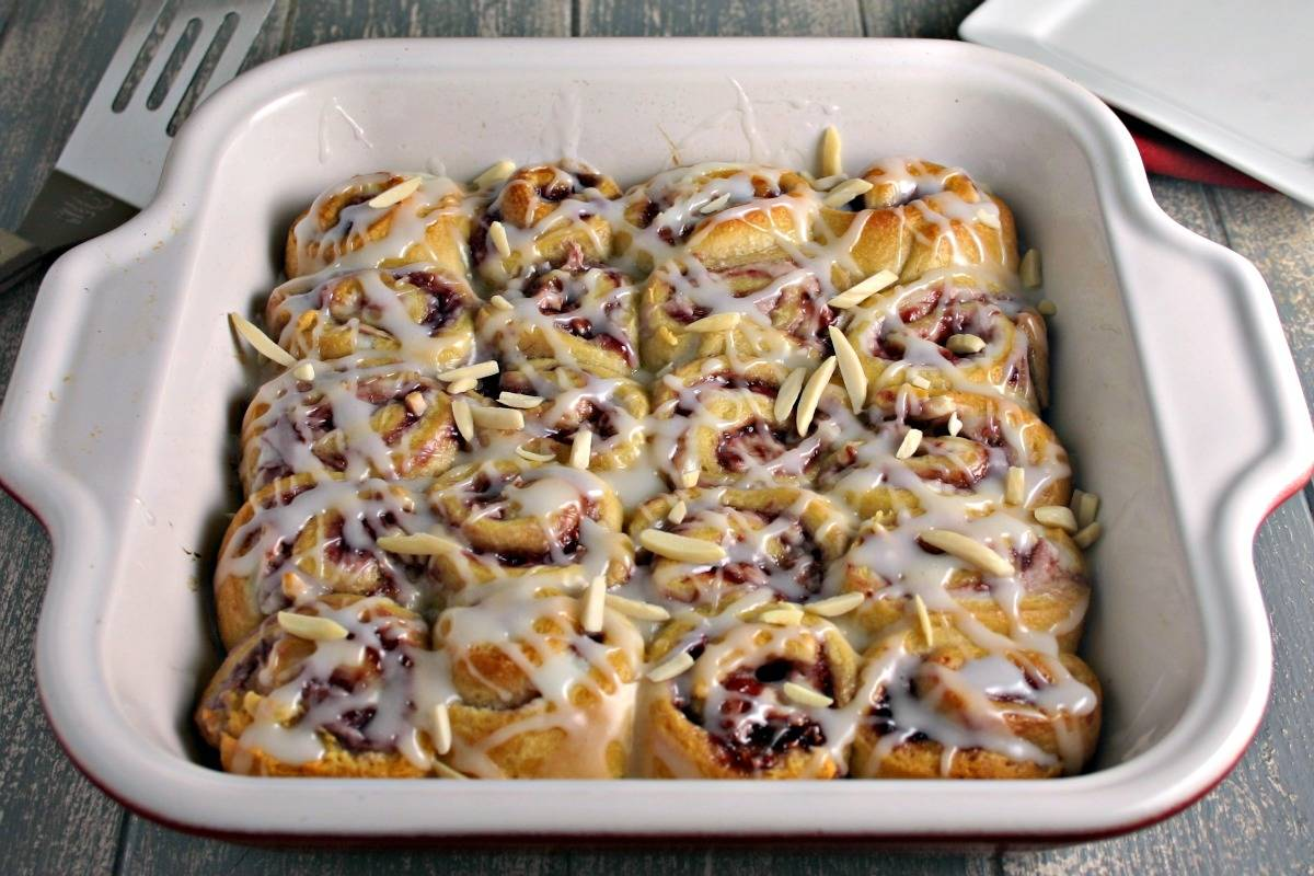 A baking dish filled with Raspberry Almond Sweet Rolls