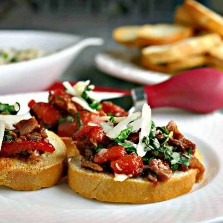 A plate of Roasted Red Pepper and Bacon Bruschetta on a table