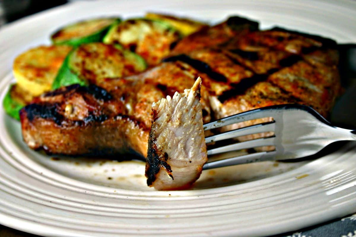 A plate of food with a fork, with Easy Magic Rub for Grilled Chops and Veggies