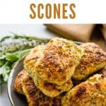 ricotta scones on a plate with fresh herbs